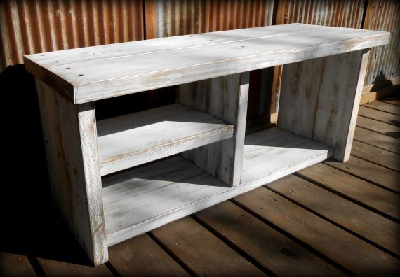 This rustic shoe rack has two shelves, a cubby for boots and it has a top to sit on. Its sanded smooth, painted distressed white & sealed with semi