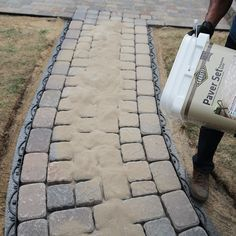 Pouring Polymeric Sand Over the Pavers.