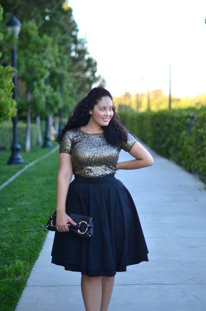 Sequin top and dark skirt.