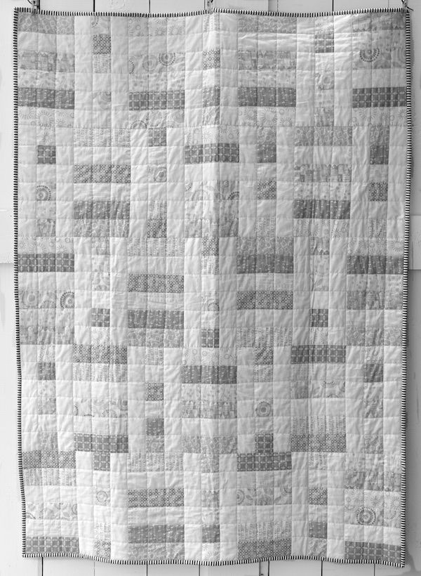 I had a vision for this quilt that I wanted something light and airy that reminded me of fresh white laundry hanging on a clothesline - lots of whites and light greys and nothing else. There were s...