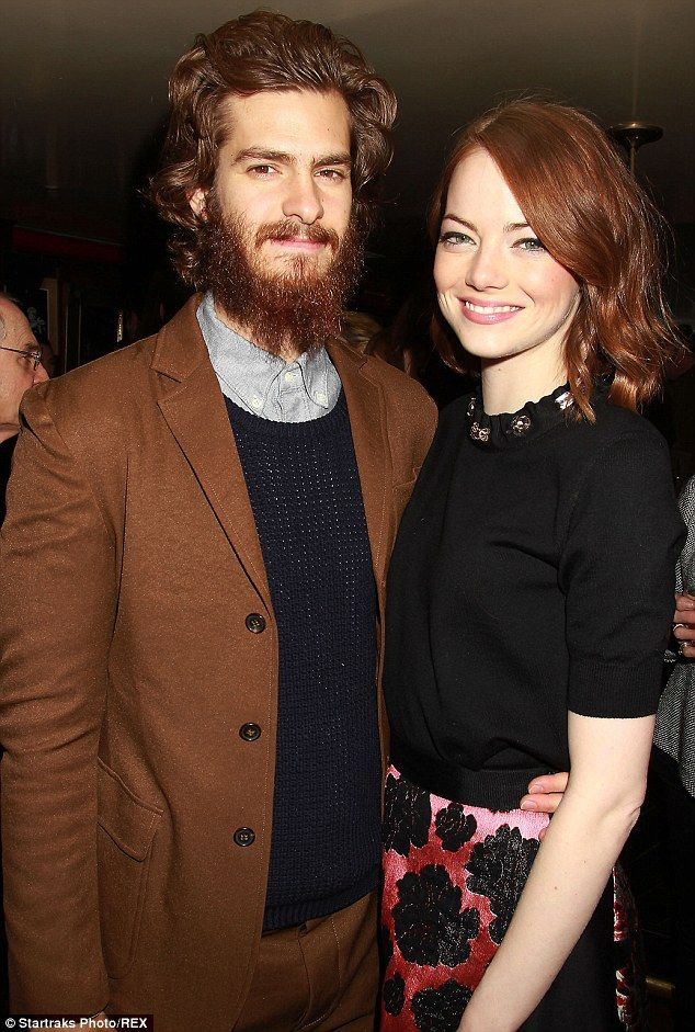 Cuddling up: Andrew Garfield put his arm around girlfriend Emma Stone's waist at a dinner and Q&A in honour of her Birdman in New York on Monday evening