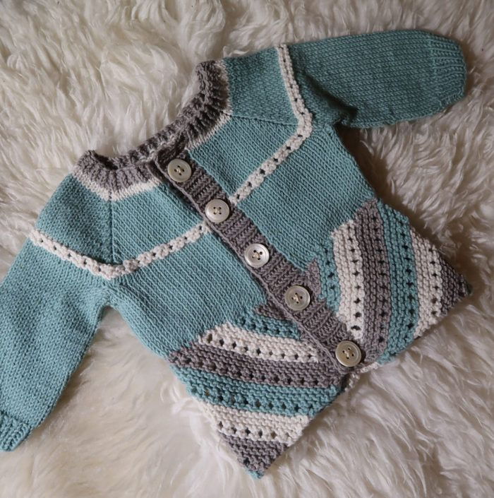 Free Knitting Pattern for Elliot Baby Cardigan - Baby sweater can be knit in 3, 2, or even 1 color featuring a bias bottom worked in two pieces of garter stitch with eyelet rows. Newborn size is free. Other sizes are available for purchase. Sport weight. Great project for scarp yarn. Designed by Kristin Blom.