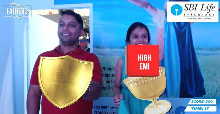 SBI Life celebrates Fathers Day at two cities - Kolkata & Mumbai (South City Mall & Mumbai - Infiniti Mall, Malad). A Father and daughter enjoying the Augmented Reality Game (a game screenshot).