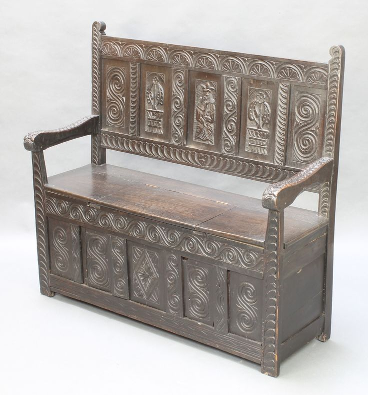 """Lot 1041, A Victorian carved panelled oak settle with raised back 42""""h x 44 1/2""""w x 16 1/2""""d est £100-150"""