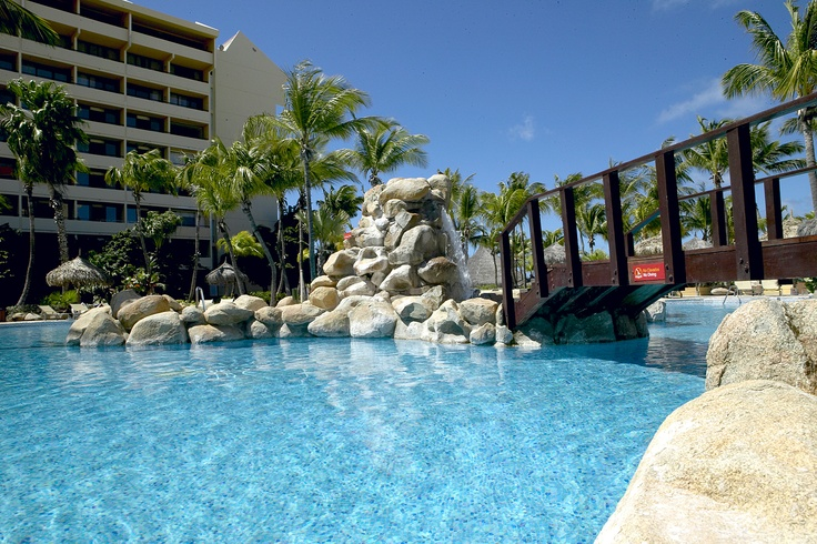 Occidental Grand Aruba-Let's swim! www.vowtotravel.com Book a well deserved getaway today!