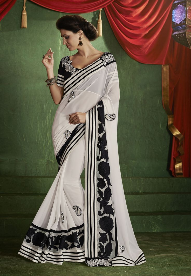 #Latest Collections!!1 #Classy Cream!!!  #White Georgette Saree designed with Heavy Resham Embroidery. As shown Black Raw Silk Blouse fabric is available which can be customized as per requirements  INR 1950.00 Only  Shop Now@ http://goo.gl/nUowsw