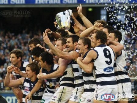 Geelong Cats celebrate during the AFL 2011 Toyota Grand Final match between the Collingwood Magpies and the Geelong Cats at the MCG, Melbourne.