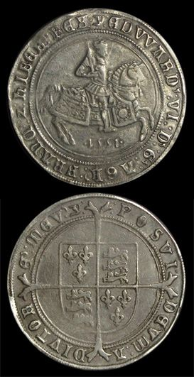 "Edward VI Crown of 1551 Fine silver issue. Date below king on horseback. Rev: shield on cross.The silver crown of Edward VI featured a striking image of the king on horseback on the obverse, and a shield and ""long cross"" (i.e. extending to the edges of the coin) on the reverse. It was also the first English coin to feature the date in Arabic (i.e. ordinary) numerals as opposed to Latin numerals."