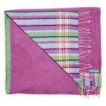 Bright fuschia pink towel with a striped cotton 'kikoy' backing of pinks and lime greens.