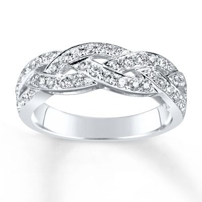 Three intertwining waves of sparkling diamonds form this exquisite anniversary band for her. Fashioned of 14K white gold, the band has a total diamond weight of 1/2 carat. Diamond Total Carat Weight may range from .45 - .57 carats.