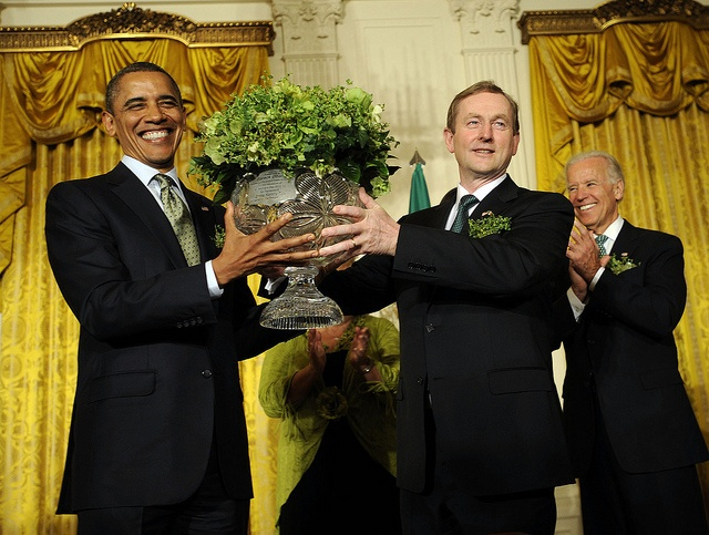 Taoiseach Enda Kenny and US President Barack Obama participate in the Shamrock Ceremony, with Vice President Joe Biden, left, during a reception in the White House, on Tuesday, March 20, 2012, in Washington, DC.