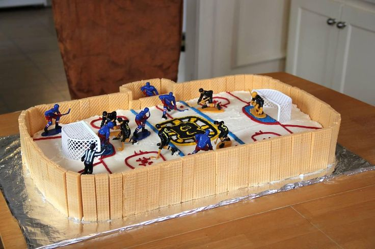 Bruins-Rangers Hockey Birthday Cake with Hockey Guys toy. (Love the wafers around the outside!)