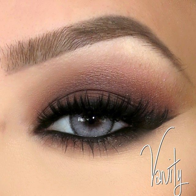 Matte brown smoky eye with blended liner all around and winged