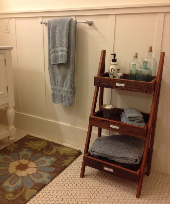Bathroom storage shelving made from reclaimed barn wood on Etsy, $115.00