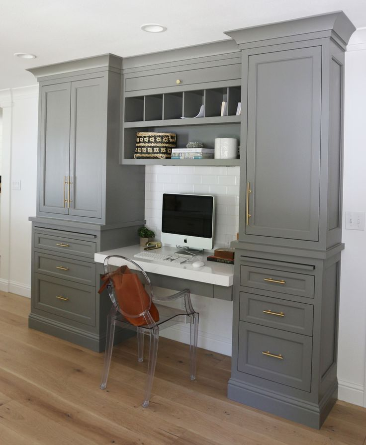 Home office/workspace with gray cabinets and lucite chair