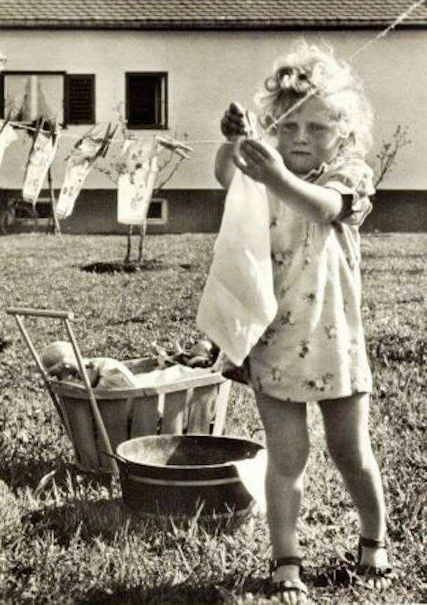 Vintage girl hanging clothes on the clothesline                                                                                                                                                      More