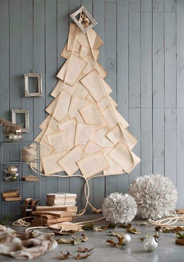 Parchment Christmas tree. There's no limit to when and where you can use imagination. This parchment Christmas tree makes use of the wall as its canvass and paints a perfect version of a Christmas tree using paper and rope.