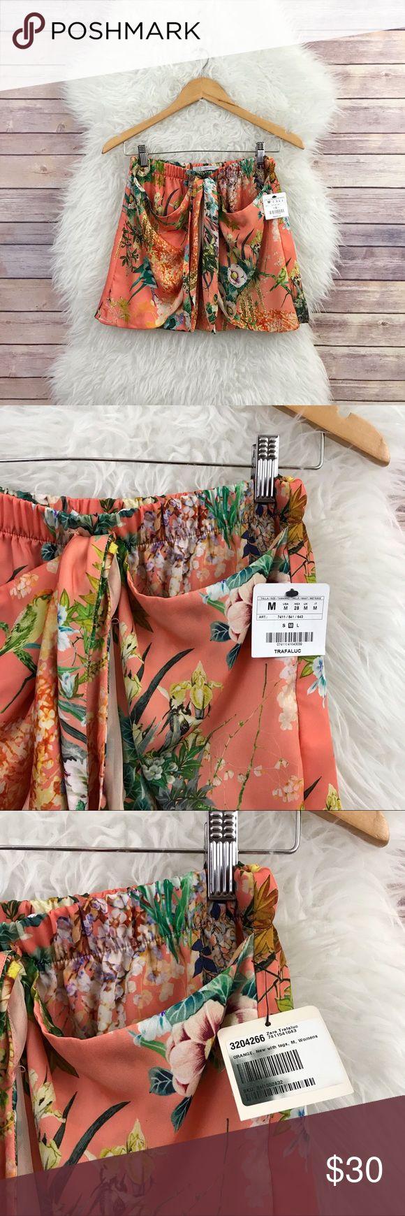 "New Zara Tropical Floral Sarong Skirt Sz M New Zara Trafaluc skirt. Size M.  // D E T A I L S ✿ * Floral print * Sarong style  * Elasticized waist  // M E A S U R E M E N T S ✿ * Waist: 13"" inches across * Length: 14.5"" inches Zara Skirts"