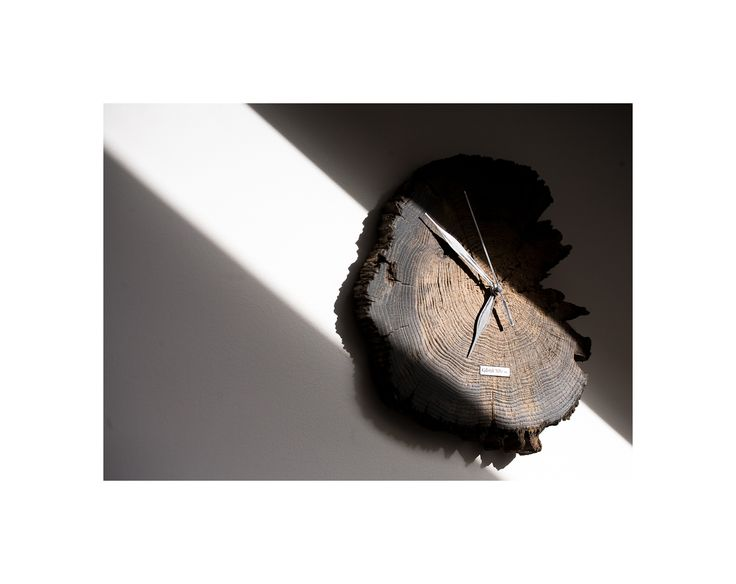 Model no 6. This clock is made of construction wood from the buildings of the Old Town of Gdansk. Black oak dating back to the 14th century.