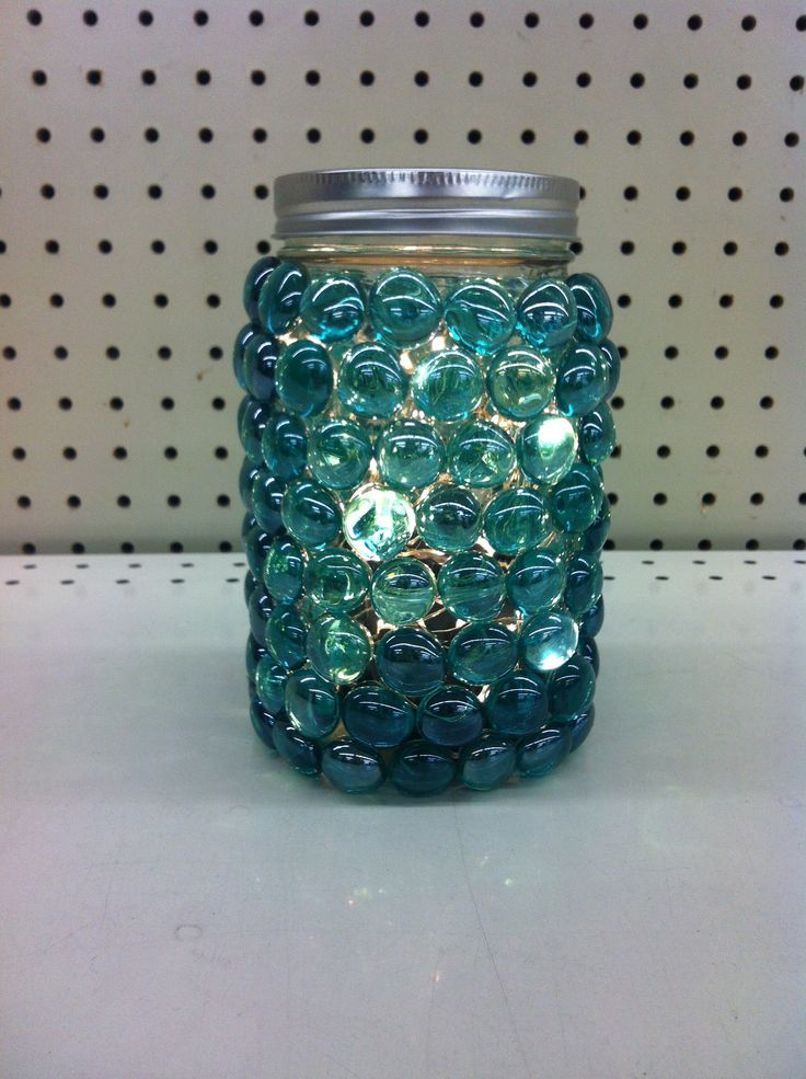 Mason jar covered in glass beads