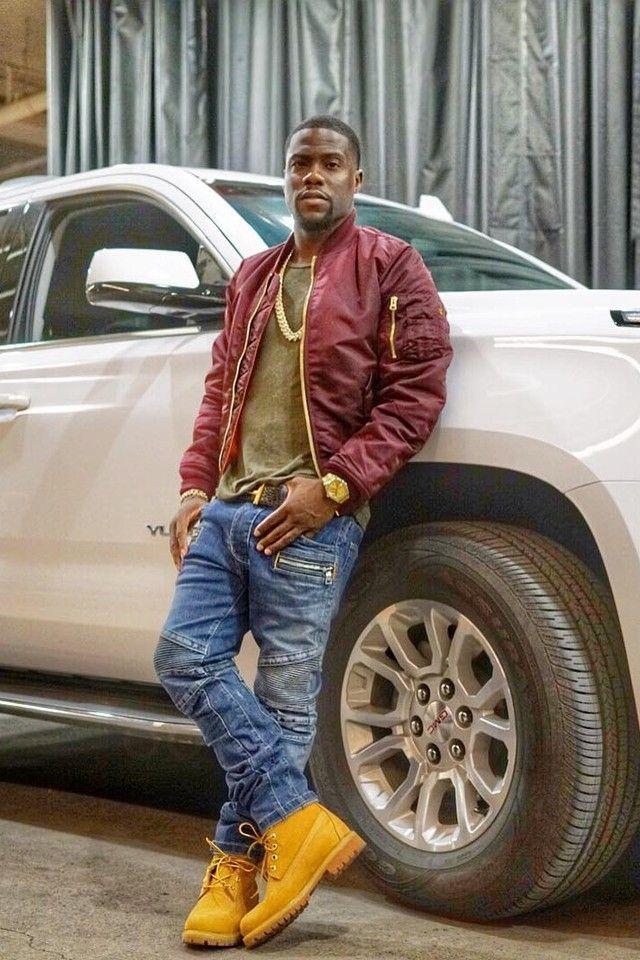 Kevin Hart wearing  Rolex Day-Date Oyster 36mm 18 Carat Watch, Balmain Denim Moto Jeans, Alpha Industries X UO Slim-Fit MA1 Bomber Jacket, Timberland Men's Premium Boot