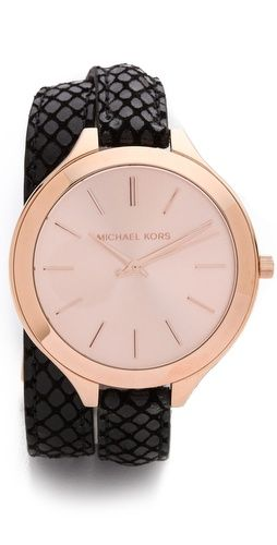 Michael Kors revamps the signature Runway watch with a snake-embossed, wraparound leather band. Black and Rose Gold.
