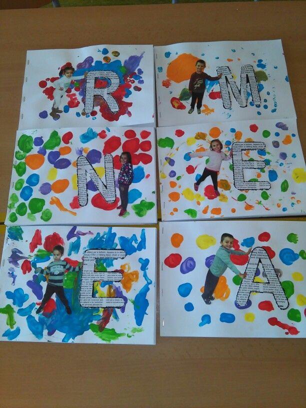 Tapa d'àlbum de P3. Fem rodonetes de colors  amb els dits  i enganxem les fotos i les inicials dels noms dels nens.