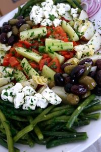 All of the flavors that make Mediterranean cuisine so famous are found in this tasty platter of fresh vegetables: smooth buttery potatoes, briny feta, savory tart olives and more! Topped with a fresh red wine vinaigrette, there isn't much this salad doesn't offer -