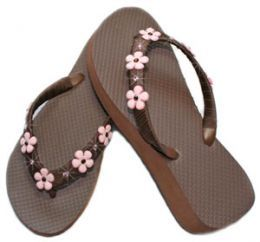 Decorate your own flip flops. @April Moss I see you doing this for your girls cheer squad!