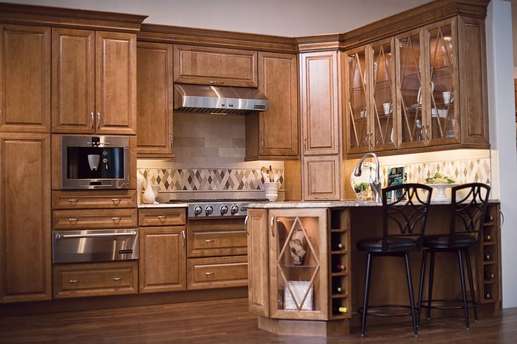 Praline Maple Cabinets Are Highlighted By Glass Doors And