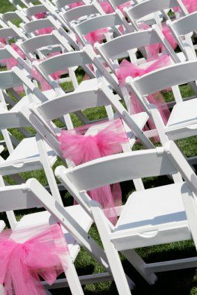 Don't want to spend that kind of money out of your wedding budget? Then get creative! Using tulle or organza, create your own beautiful bows tied in a big sheer puffs of color! For a lot less money, you can create a sea of color across your seating area.    It is not necessary to tie the bows to every single chair - count off an equal amount and tie on every third or fourth chair instead.