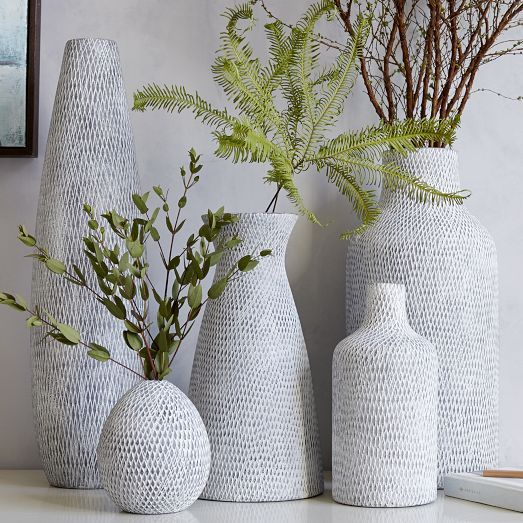 Made from earthenware stamped with small-scale patterns, our Textured Pure Ceramic Vases come in a range of shapes and sizes. Group a few together for a sculptural arrangement. 5 shapes — each under $50!