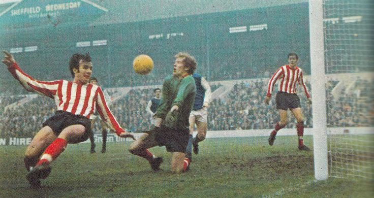 7th February 1970. Southampton goalkeeper Eric Martin blocks a shot from a Sheffield Wednesday player.
