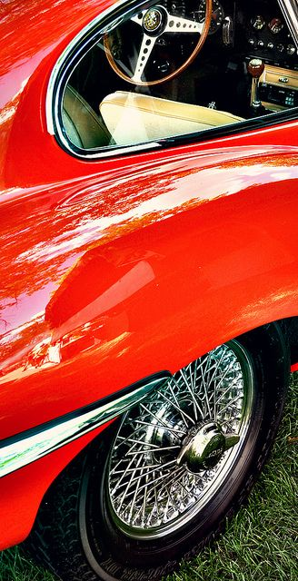 Peek-a-boo.....Jaguar E-Type in Fastback Red...check out the wires and spinners too ! By Daniel Lenghea. A car that on the red carpet celebrities choose. Justin Bieber, Roger Federer, Novak Djokovic, Paris Hilton, Sophia Vergara, Daniel Lenghea, Ortansa Lenghea, Donald Trump, Gossip