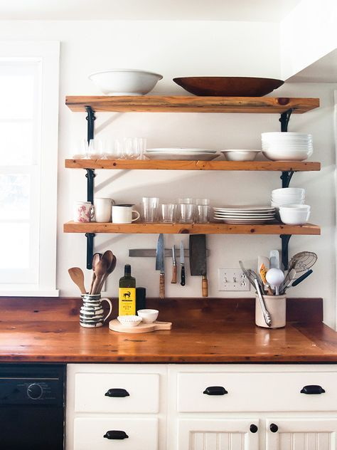 open shelving that puts focus on the everyday glasses, cups, plates and bowls that they actually use