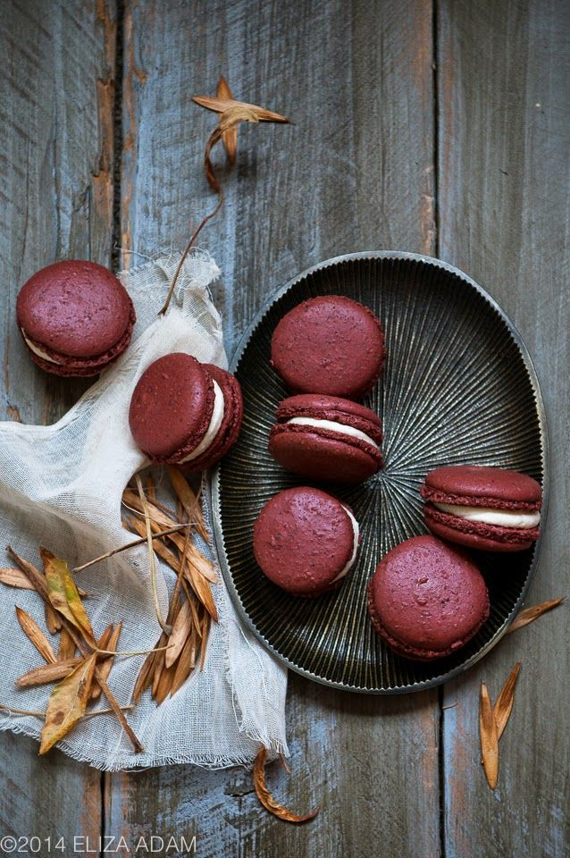 red velvet macarons filled with a cream cheese buttercream