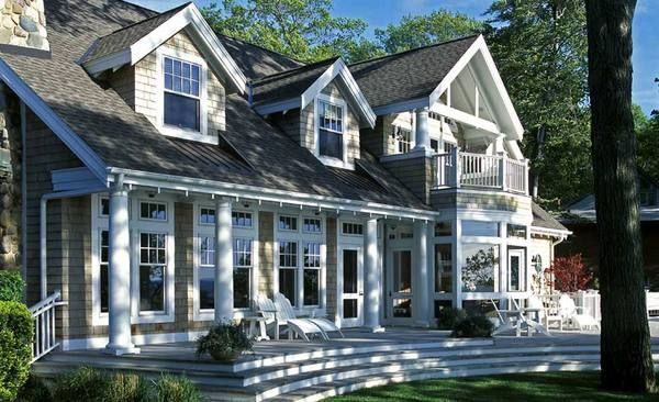 Generous views from this stunning new england shingle for New england cottage style