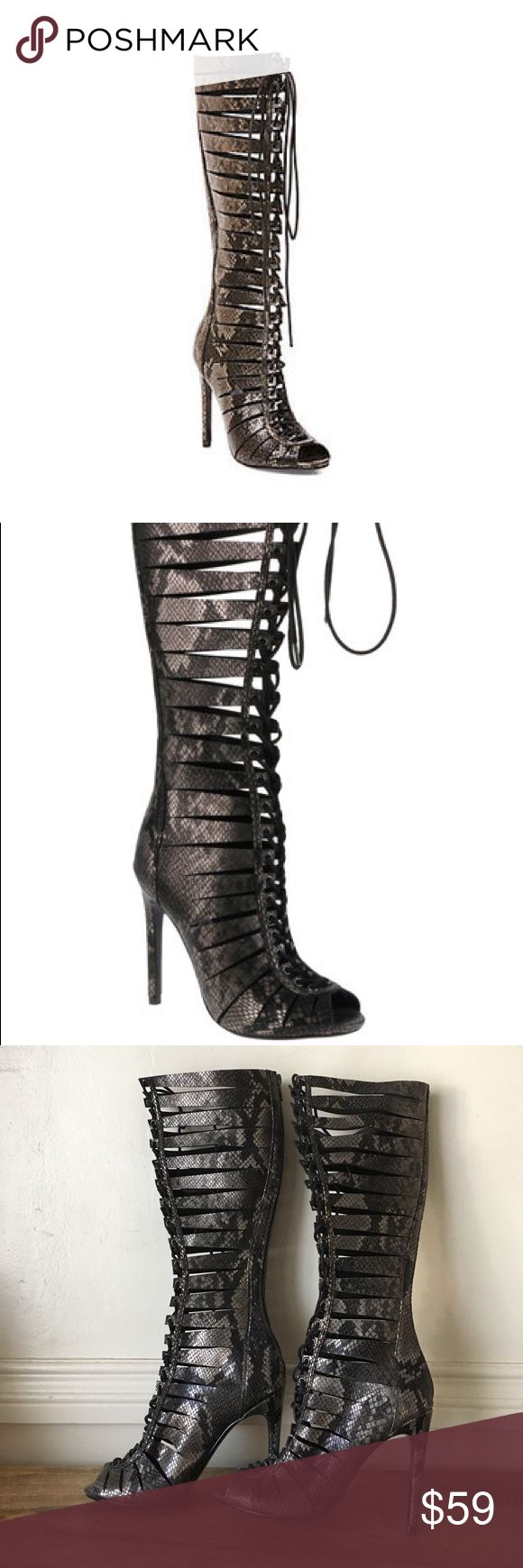 STEVE MADDEN CRYPIC LEATHER GLADIATOR HIGH HEELS Be a fashion warrior in these Cryptic Leather Gladiator High Heels by Steve Madden. In sultry black snake skin-like leather, these heels extend up to the knee with a pee toe and a lace fed through the front loops up to the top. You feel stylishly empowered when you step into room wearing this killer heels, you can pair them with a short LBD to give the dress a sexy edge! Gently worn a few times with scuffs and marks from normal wear but no…