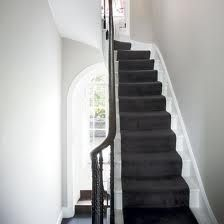 Dark grey carpet on stairs, looks good with white treads and same colour as tiles in kitchen floor