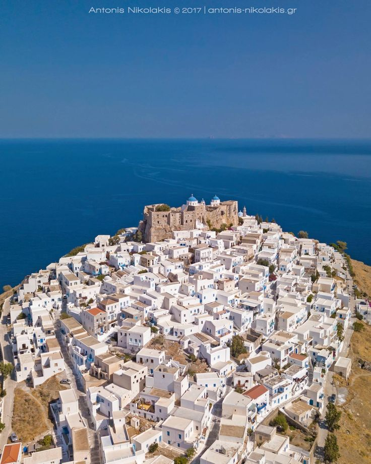 Astypalaia's Chora, the ultimate beauty of the Aegean Sea! → http://www-astypalaia-island.gr/astypalaia-chora …  Aerial Photo: Antonis Nikolakis Photography