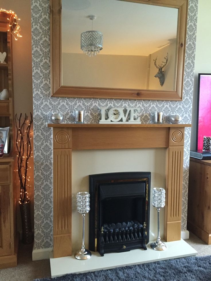 Happy with the grey/silver wallpaper and bling in our new lounge. #lounge #fireplace #wallpaper #greysilver
