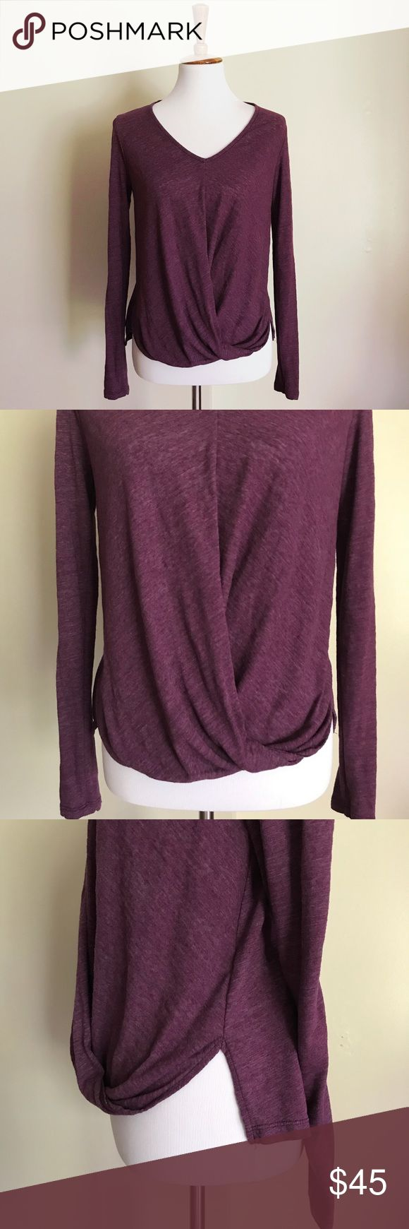 Heather Purple Long Sleeve Tee With Front Detail Velvet by Graham and Spencer. Heather Purple Long Sleeved Tee Shirt. Gently used, good condition. Front detail that looks like the fabric is wrapped or noted. Slits on each side sort of separate the front and back. I think this top looks cute with the back tucked into jeans and the front left out for an over all Slouchy look. Velvet by Graham & Spencer Tops Blouses