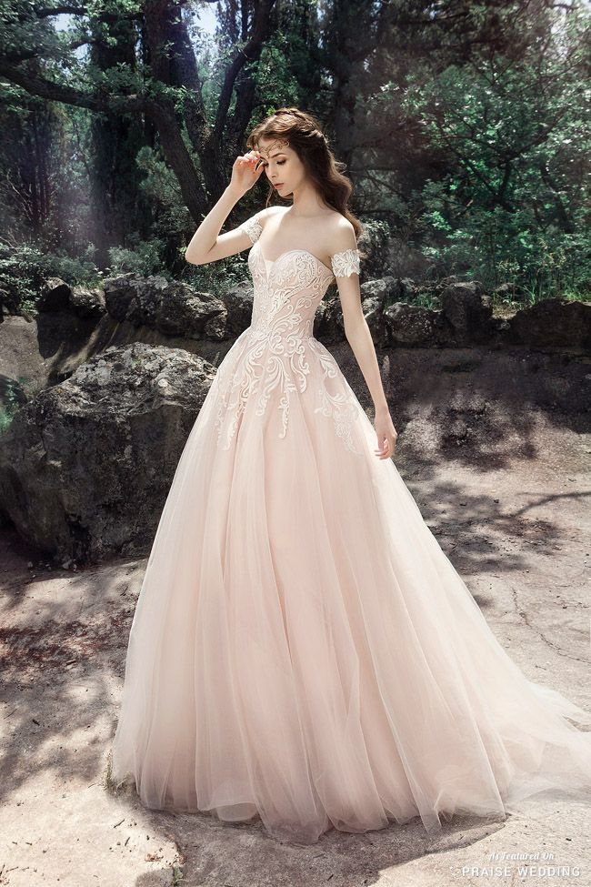 Chic, feminine, and whimsical, this pastel pink gown from Milva is like a dream come true! » Praise Wedding Community