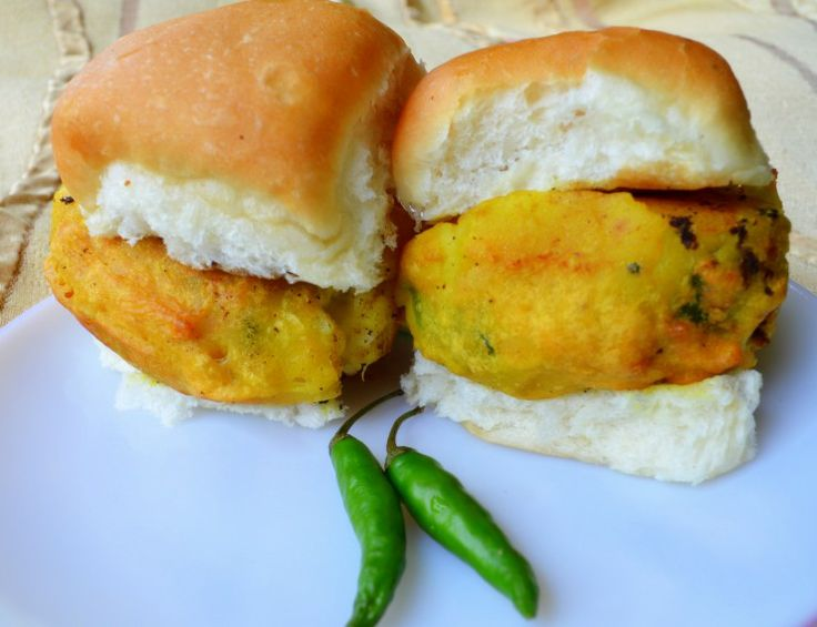 Vada Pav is a popular vegetarian fast food dish native to the Indian state of Maharashtra. It consists of a batata vada sandwiched between 2 slices of a pav. The compound word batata vada refers in Marathi and Gujrati to a vada (fritter) made out of batata, the latter referring to a potato. Pav refers to unsweetened bread or bun.