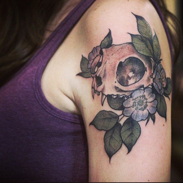 Piece by alice carrier  Dahlias, alberta roses and forgetmenots with fern greens & a cat skull at this angle  Casper Mulridge