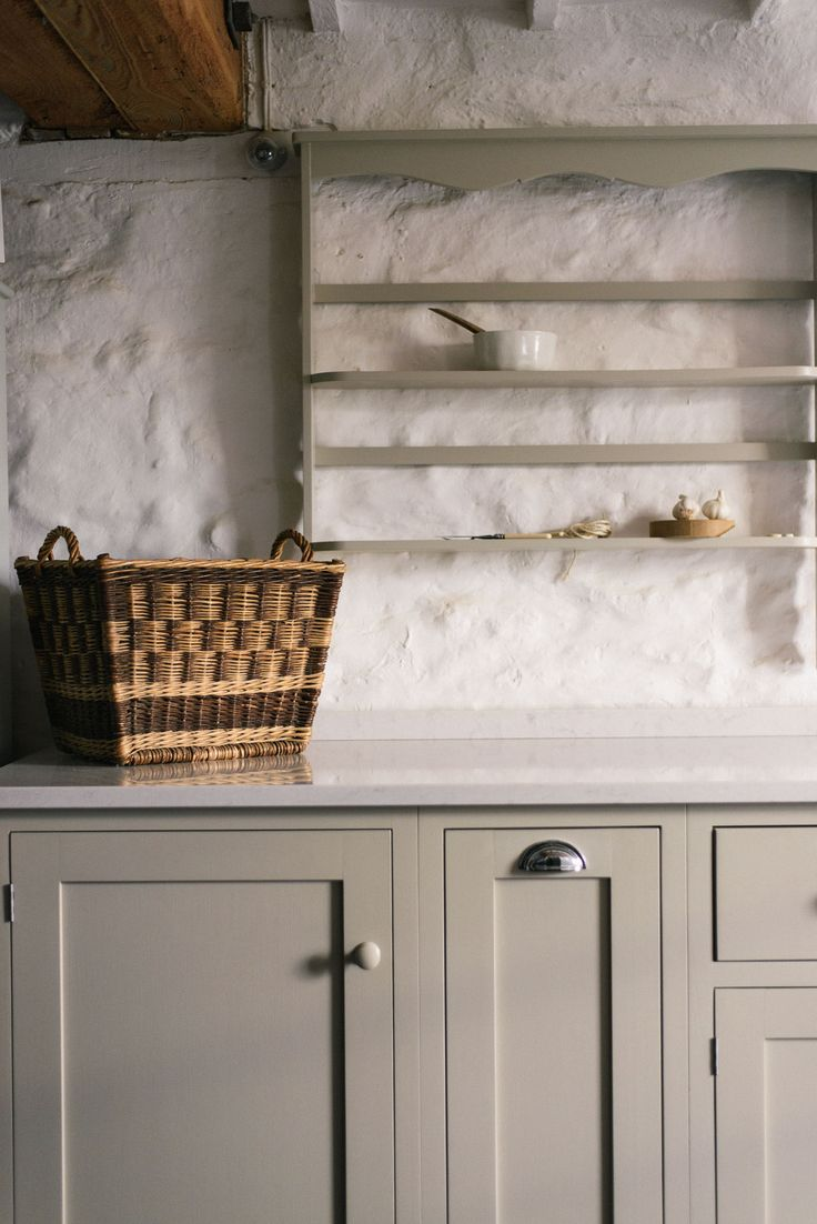 A beautiful wicker basket in a lovely deVOL Shaker kitchen