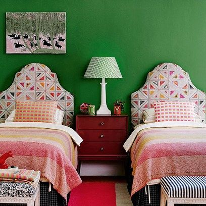 Discover bedroom design ideas on HOUSE - design, food and travel by House & Garden including this bold design featuring padded headboards and wool blankets.
