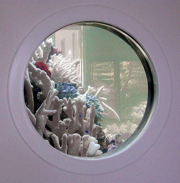 Porthole Aquarium. Cute idea for children's area.
