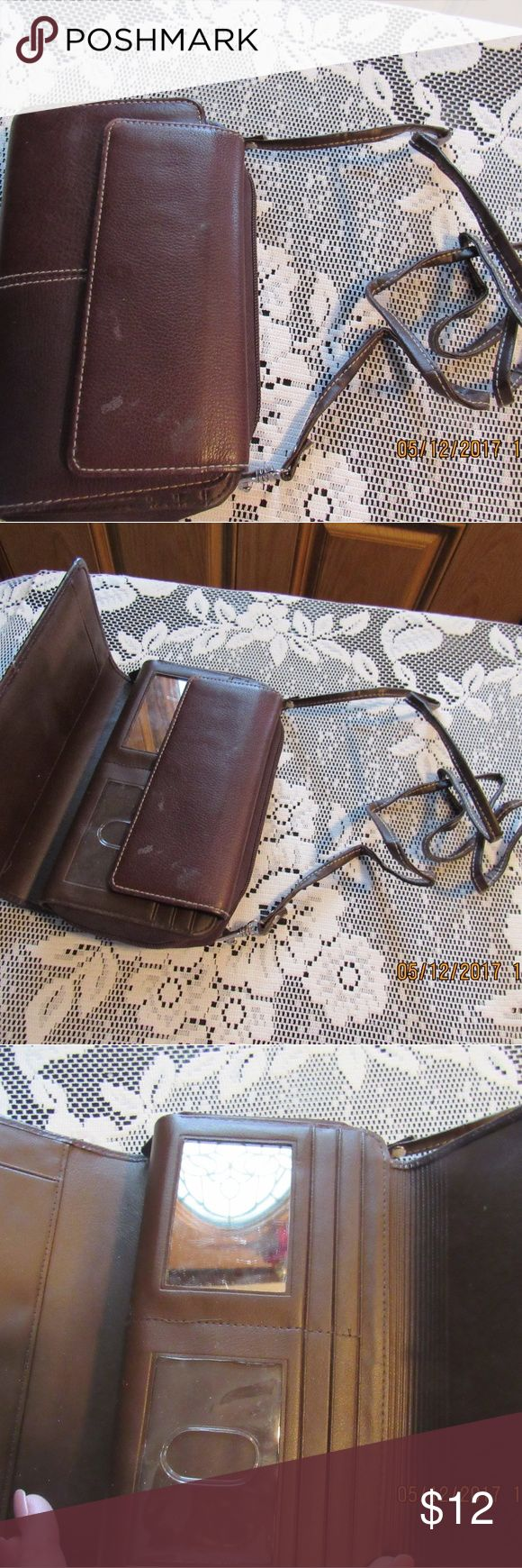 JB307.   Buxton Leather Wallet Brown genuine leather Buxton wallet.  Lots of storage and has strap to wear as crossover.  There are a few marks on front flap but other than that in good used condition. Buxton Bags Wallets