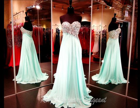 This strapless dress is simple and elegant! The heavily beaded angled bodice is the main attraction for this gown and it's sure to sparkle!